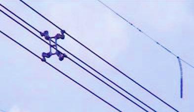 Alacrán. Contrapeso que evitar el giro del cable de fibra óptica.